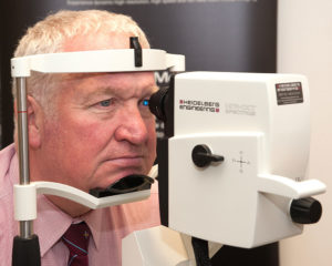 MP Sir Mike Penning sitting in front of a SPECTRALIS